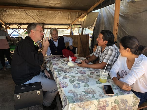 Fr Tom Greene listens to migrant stories